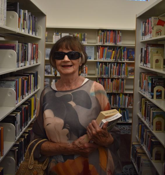 OUTLOOK PHOTO: TERESA CARSON - Joinell Friedstrom visits the Gresham Library once per week and is an avid fan of mysteries.
