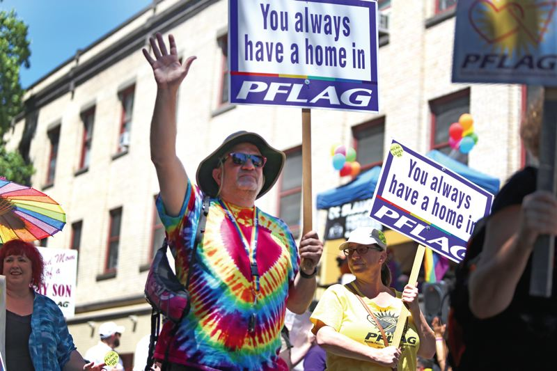 PORTLAND TRIBUNE: JESSIE DARLAND - Members of Parents and Families of Lesbians and Gays (PFLAG) march in the Pride Northwest parade on June 17 in downtown Portland. PFLAG is a free family support group for those with loved ones who are LGBTQ.