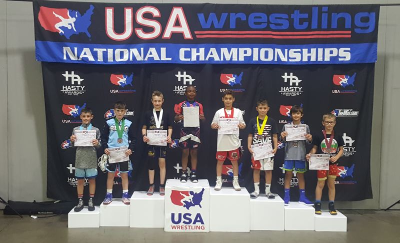 TOM NEKVAPIL PHOTO - Oregon City's Carter Nekvapil (third from left) finished third in the intermediate 77-pound division at the USA Wrestling Kids Freestyle National Championships in Atlanta, Georgia.