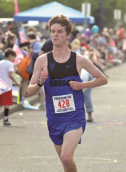 PIONEER PHOTO: TANNER RUSS - Freedom 5K top finisher Jason Rae of Portland