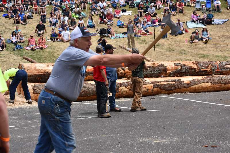 ESTACADA NEWS PHOTO: EMILY LINDSTRAND - Andy Rolston, a finalist in the 2018 Estacada Timber Festival axe throw, prepares to hit the target on Wednesday, July 4.