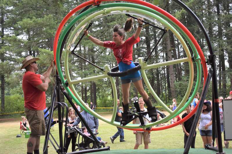ESTACADA NEWS PHOTO: EMILY LINDSTRAND - The Estacada Timber Festival on Wednesday, July 4, featured many activities for children, including a hang gliding ride.