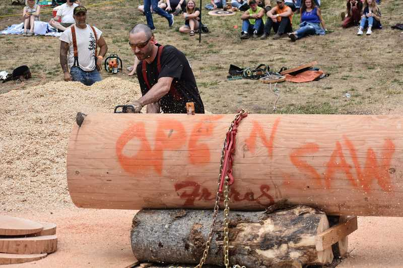 ESTACADA NEWS PHOTO: EMILY LINDSTRAND - A competitor in the 2018 Estacada Timber Festival saws as quickly as he can.