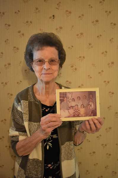 ESTACADA NEWS PHOTO: EMILY LINDSTRAND - Leona Campanella holds a photo of her family that was taken in 1964. She and her husband, Fred, had nine children.