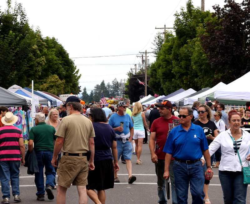 COURTESY PHOTO - Hundreds peruse the dozens of vendors lining the streets of Donald during the annual Donald Hazelnut Festival. This year, the festival falls on Saturday, July 14.
