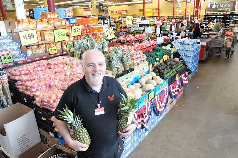 GARY ALLEN - John Elliot worked as a manager at Safeway stores in the Portland area for nearly two decades before buying the Grocery Outlet store in Newberg. He and his wife, Shari, took over operations of the store in June and have many plans in mind.
