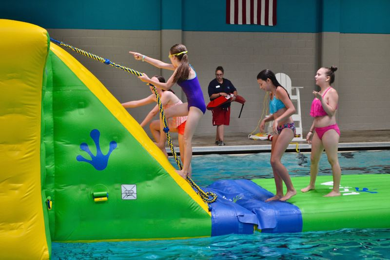 POST PHOTO: BRITTANY ALLEN - Families swam free of charge on July 5 after the reopening of the Olin Y. Bignall Aquatic Center.