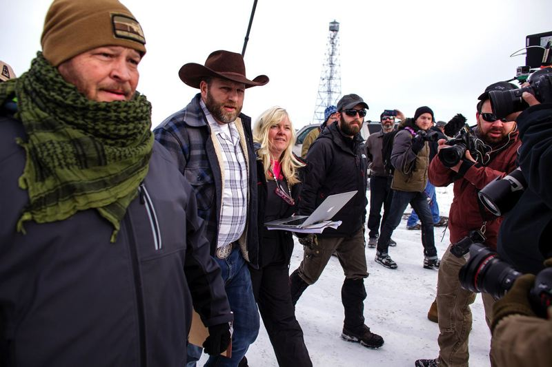 PAMPLIN MEDIA GROUP FILE PHOTO - A group of armed people joined Ammon Bundy during a 41-day standoff at the Malheur National Wildlife Refuge in Harney County. The group was protesting federal prosecution of Dwight and Steven Hammond, ranchers who were convicted of arson for setting fires on BLM land.