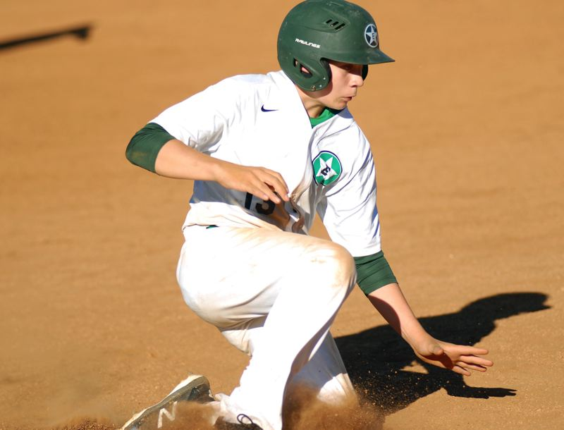 ESTACADA NEWS: MATT RAWLINGS - Jacob Sittner pops up after stealing third base in Estacada's 18-6 loss to Oregon City.