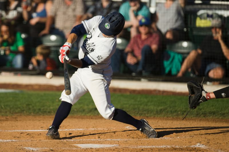 TRIBUNE PHOTO: KIT MACAVOY - Second baseman Carson Breshears connects at the plate for the Portland Pickles in their Tuesday night win against the Walla Walla Sweets at Walker Stadium.