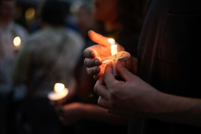 TRIBUNE PHOTO: KIT MACAVOY - People gathered near the spot where Jason Washington died on Southwest College Street for a Friday night candlelight vigil.