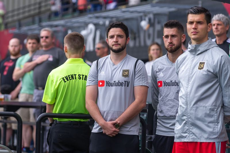 TRIBUNE PHOTO: DIEGO G. DIAZ - Mitchell Monihan (third from right) observes as Los Angeles FC warms up at Providence Park before its May 19 MLS game against the Portland Timbers.