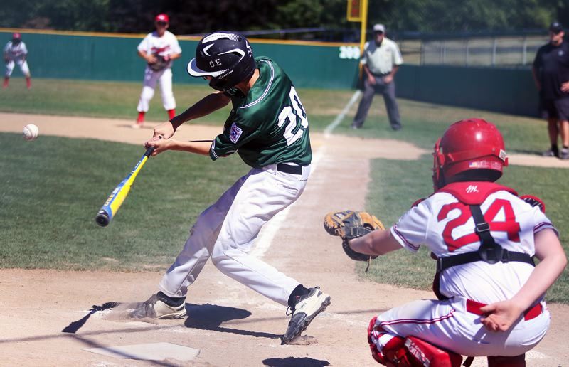 TIMES PHOTO: DAN BROOD - Tigard Little Leagues Owen Erb puts the ball in play during action at Sundays District 4 tournament game at Alpenrose Stadium.
