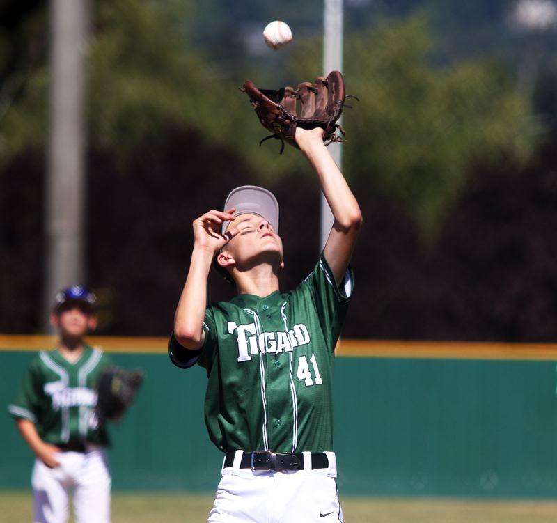 TIMES PHOTO: DAN BROOD - Tigard Little Leagues Ryder Eaton catches a pop-up during action Sunday at the District 4 Majors All-Star Tournament.