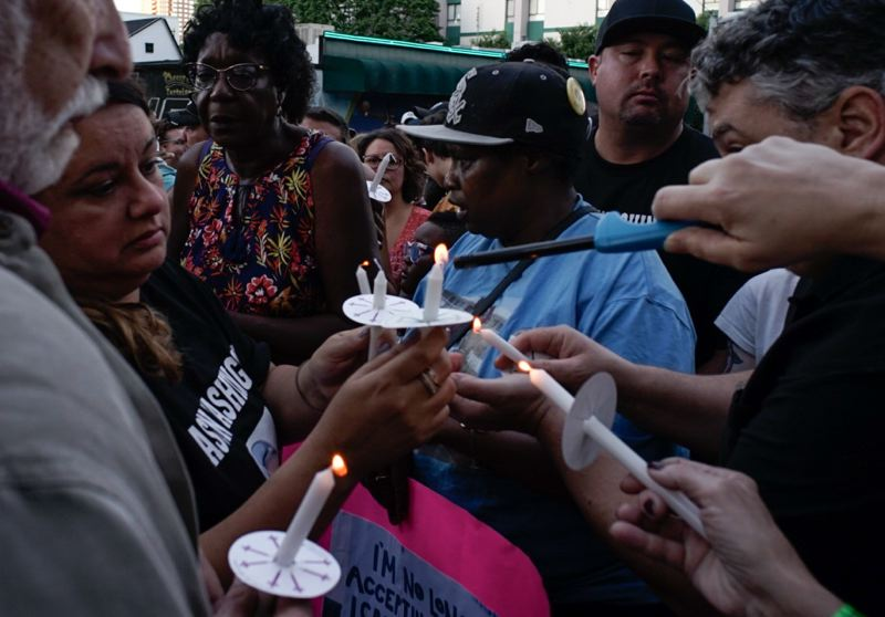 TRIBUNE PHOTO: KIT MACAVOY - At a July 6 vigil, mourners gathered holding signs and candles while wearing T-shirts in honor of Jason Washington, who was shot and killed by Portland State University officers June 29.