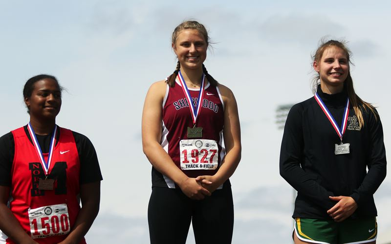 TIMES PHOTO: DAN BROOD - Shelby Moran (center) won a pair of state titles at the Class 6A state track and field championships.