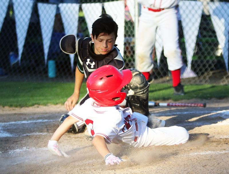 TIMES PHOTO: DAN BROOD - Tigard Little League catcher Dominic Taylor tags out a Murrayhill player during action at the District 4 tournament title game.
