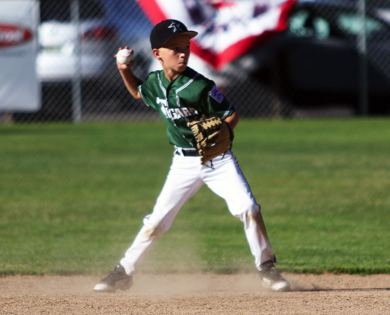 TIMES PHOTO: DAN BROOD - Tigard Little League second baseman Andrew Hergert gets ready to make a throw to first in the District 4 championship game.