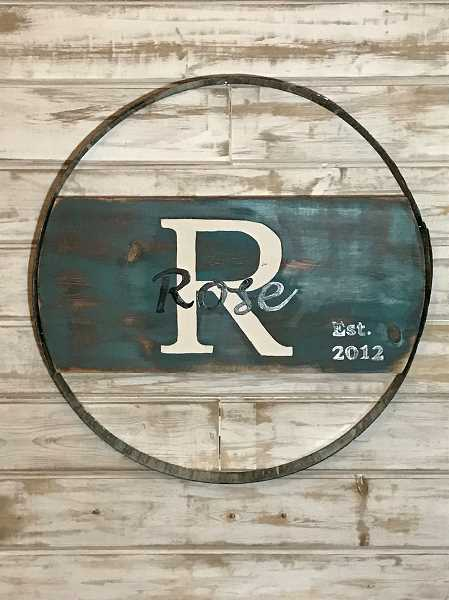 SUBMITTED PHOTO  - Learn how to make this attractive wine barrel sign at workshops taking place July 14 and Aug. 11.