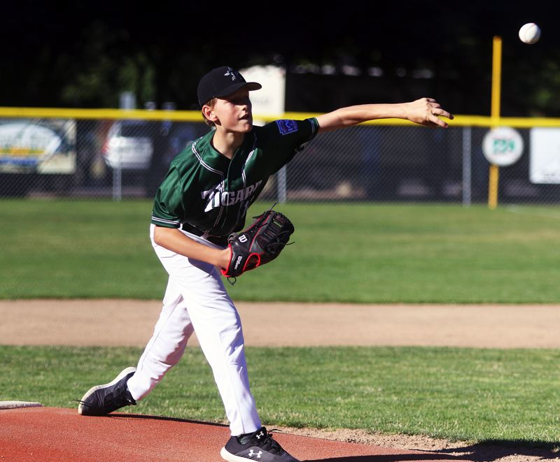 TIMES PHOTO: DAN BROOD - Tigard's Alex Pearson fires a pitch to the plate in the District 4 championship game.