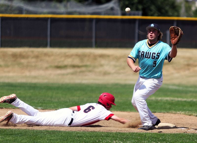 TIMES PHOTO: DAN BROOD - Tualatin first baseman Gavin Moore (right) reaches for the ball on a pickoff play during Fridays game.