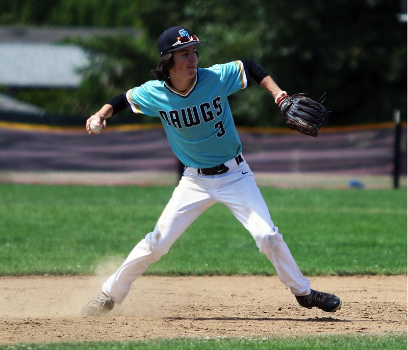 TIMES PHOTO: DAN BROOD - Tualatin Dawgs shortstop Joey Myers looks to make a throw to first base during the team's game with the Bozeman Bucks at the Clackamas Diamond Classic.