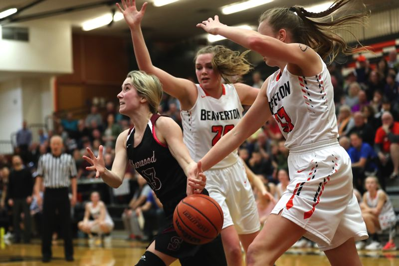 TIMES PHOTO: JAIME VALDEZ - Lauren Scarvie, left, looks to drive to the basket during the Lady Bowmens state playoff second-round game at Beaverton.
