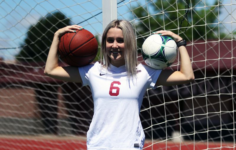 TIMES PHOTO: DAN BROOD - Lauren Scarvie balanced both soccer and basketball during her four years at Sherwood High School.