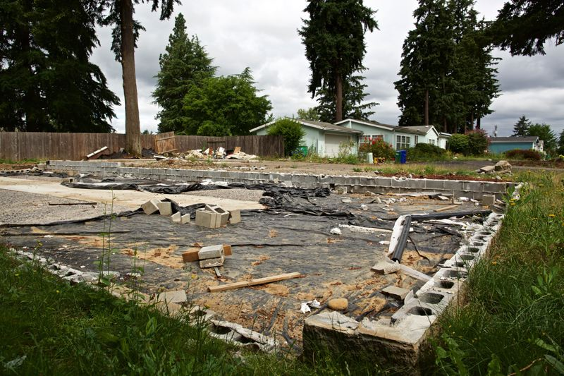 TRIBUNE FILE PHOTO  - This was all that remained of a double-wide manufactured home at the Lostinda Woods complex in East Portland, after a new owner nearly doubled the space rents and jacked up utility payments.