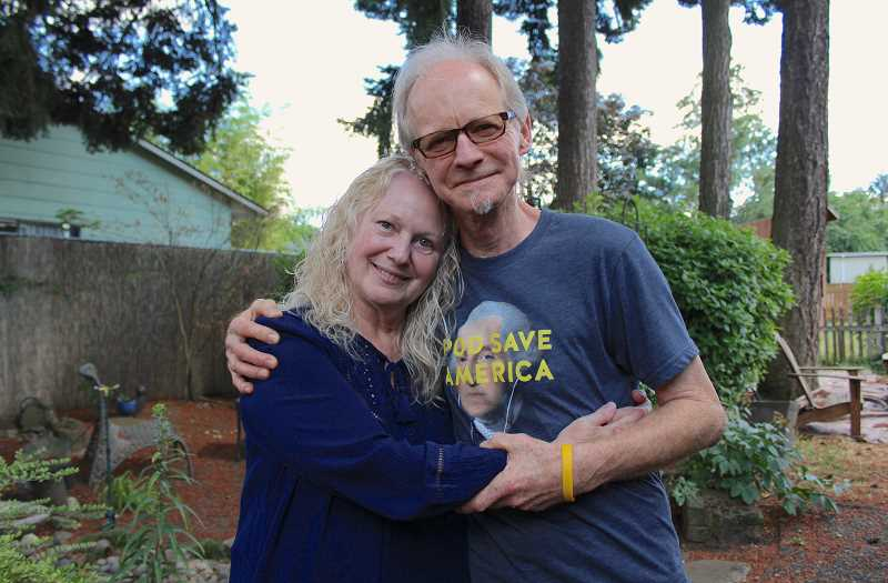 REVIEW PHOTO: SAM STITES - Kenny and Pat Sawyer pose in the backyard of their Southeast Portland home. A benefit concert on July 22 will help cover medical expenses related to Kenny;s bouts with cancer.