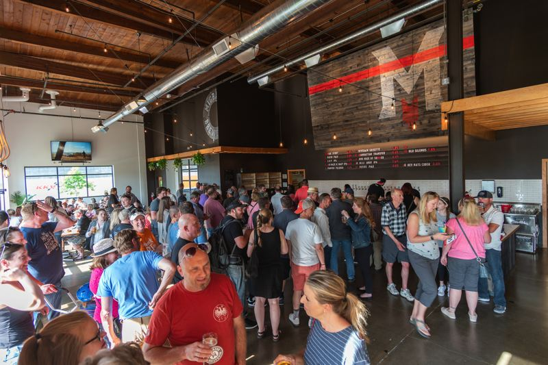 CONTRIBUTED PHOTO: MIGRATION BREWING CO.  - Patrons mingle on opening day, June 2, at Migration Brewing at 18188 N.E. Wilkes Road in Gresham. The facility is Migrations second in the Portland area. The location at 2828 N.E. Glisan Street opened in 2010.