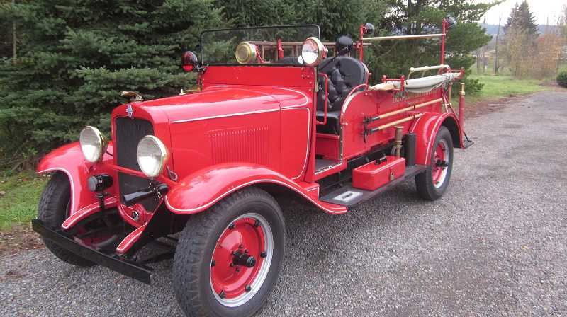 SUBMITTED PHOTO - Happy Valley resident David Koetje's red 1931 Chevrolet Hose Wagon was used in limited fire suppression duty at a California lumber mill until 1990, when it was retired and completely restored.