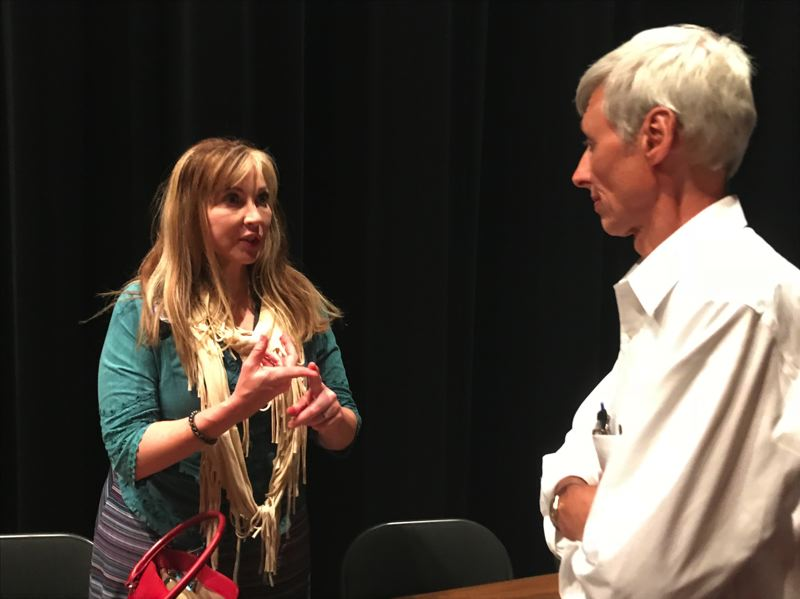 TIMES PHOTO: DANA HAYNES - State Sen. Kim Thatcher talks to former Tualatin School Board member Barry Albertson on Wednesday in Beaverton.