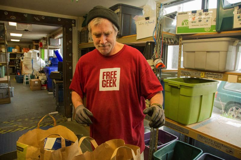 FILE PHOTO COURTESY OF METRO - Ron Spray sorts through electronics dropped off at Free Geek in Southeast Portland for recycling.