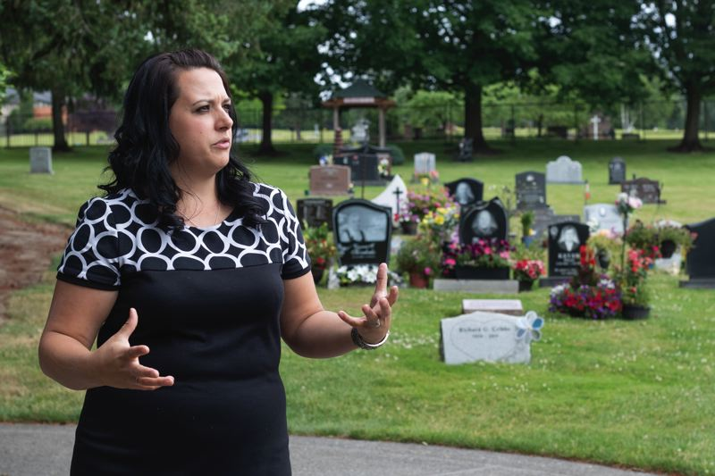 TRIBUNE PHOTO: JONATHAN HOUSE - Sunnyside Little Chapel of the Chimes general manager Mindy Barella talks about the different types of placement available in the garden and cemetary.