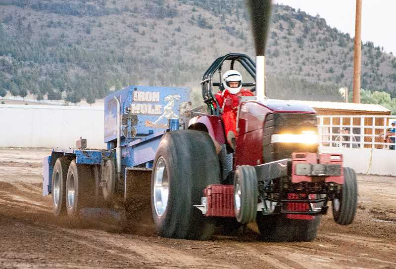 JAMIE WOOD/CENTRAL OREGONIAN - Chris Taber of Shoshone, Idaho, won both days of the smoker tractor with runs of 416.58 feet on Friday and 461.37 Saturday at this past weekend's Prineville Truck and Tractor Pull.