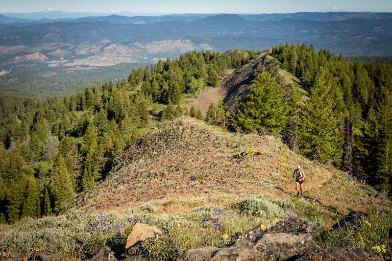 PHOTO COURTESY OF OCHOCO TRAIL RUNS - A runner toils up a hill during the Second Annual Ochoco Trail Runs. The endurance test featured 50-mile, 50-kilometer, and 10.5-mile runs on narrow trails with difficult climbs. The 50-mile run featured roughly 9,000 feet of elevation gain and loss.