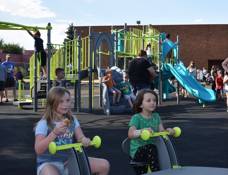 OUTLOOK PHOTO: TERESA CARSON - Some Hollydale Heroes enjoying their new playground.