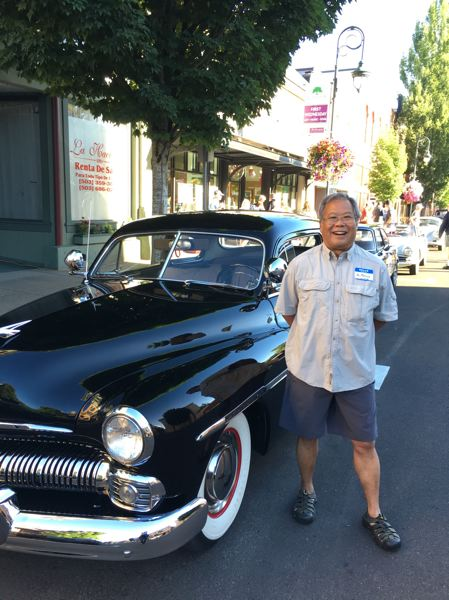 PAMPLIN MEDIA PHOTO: JOHN SCHRAG - Mel Matsuda of Cedar Mills attended the Vineyard Tour along with his wife Stacy, driving their 1950 Mercury. Matsuda, who has a dental practice in Hillsboro, said he bought the car a few years ago from a friend, and will be displaying it at tomorrow's Forest Grove Concours d'Elegance for the first time.