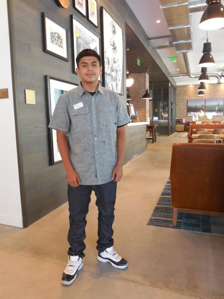 PHOTO: JOSEPH GALLIVAN - Max Valdevia, 16, a lobby attendant at the Canopy by Hilton Portland Pearl District. The hotel has a policy of hiring youth and met him at a job fair which was put on by Worksystems Inc. The organization uses grants to pay the wages of opportunity youth who not in school or working, with a view to getting them into unsubsidized jobs with key employers later.