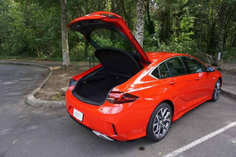 PORTLAND TRIBUNE: JEFF ZURSCHMEIDE - Instead of a traditional sedan trunk, a large rear hatch opens to reveal an easily accessible cargo area. You can flip the rear seats down and create 60.7 cubic feet of carrying capacity.
