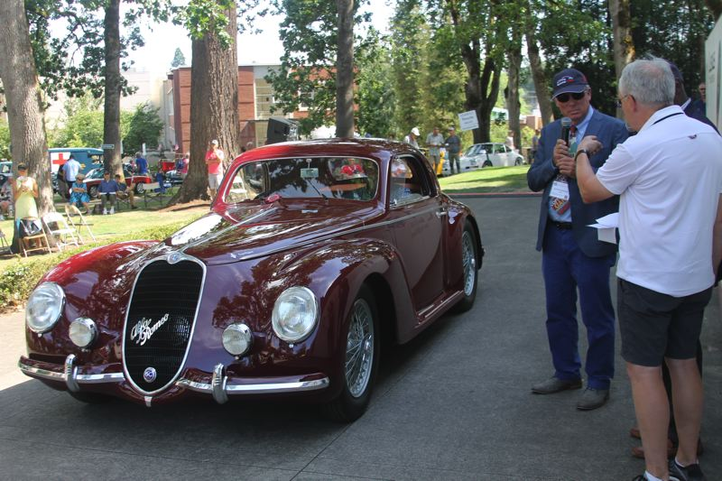 SUBMITTED PHOTO - David B. Smith of Medina, Wash., talks to 2018 Forest Grove Concours d'Elegance emcee Keith Martin about his Best in Show-winning 1939 Alfa Romeo 6C 2500 256 Corsa (pictured).