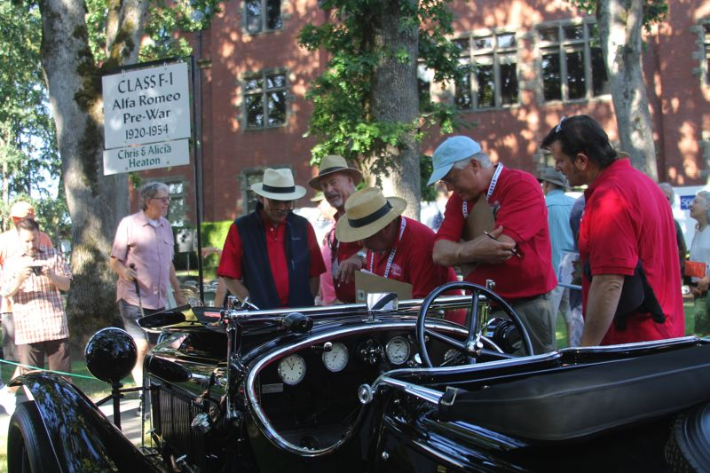 PAMPLIN MEDIA PHOTO: JOHN SCHRAG - Bob Ames of Portland (in blue vest) talks to the judges who are examining his 1929 Alfa Romeo Zagato Roadster, which he brought to the 2018 Forest Grove Concours d'Elegance.