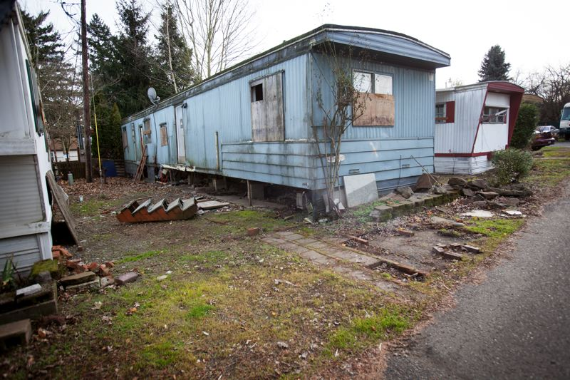 PORTLAND TRIBUNE FILE PHOTO - A single-wide mobile home at the Oak Leaf park on Northeast Killingsworth sits empty and boarded up. St. Vincent de Paul of Lane County is refurbishing some of the units and replacing others.
