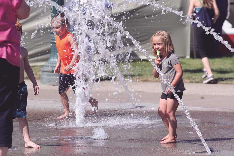 INDEPENDENT FILE PHOTO - Children enjoy the splash pad at Rivenes Park during last year's Hop Festival.