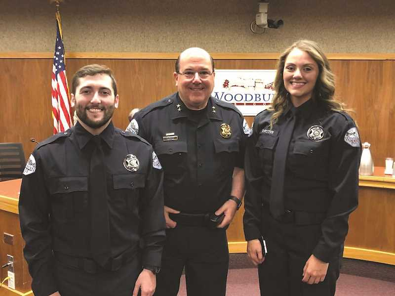 COURTESY PHOTO: CITY OF WOODBURN - Police Chief Jim Ferraris (center) stands with the newly sworn-in officers: Brendan Darby (left) and Darlyn Chester.
