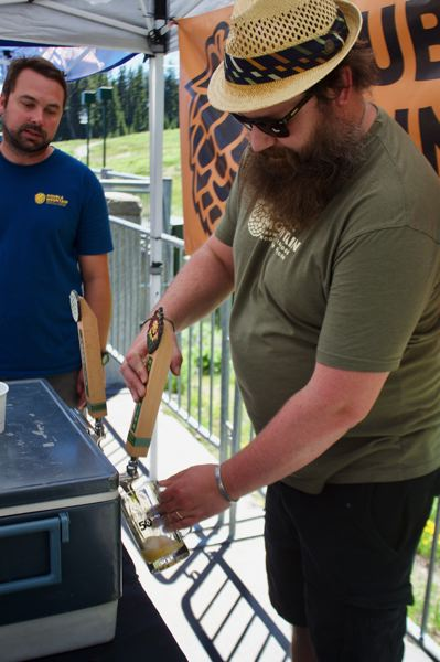 PAMPLIN MEDIA GROUP PHOTO: CHRIS KEIZUR - Phil Moulton, Double Mountain Brewing's taproom manager, pours a beer during the Mt. Hood Meadows Brew Fest, which celebrated the resort's expanded days of operation this summer.