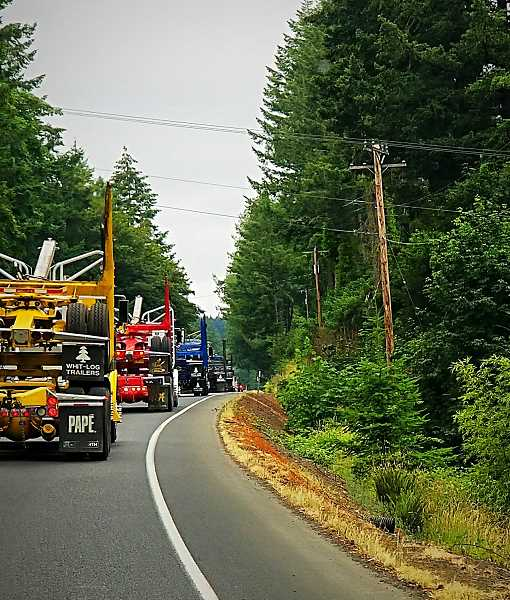 CONTRIBUTED PHOTO: ANGIE CURRY LEMKE - Trucks in Sean Lind's memorial convoy on Saturday, June 30, are seen driving toward Springwater Road.