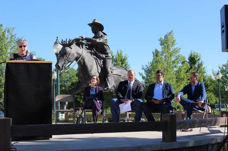JASON CHANEY - Prineville Mayor Betty Roppe speaks to a crowd gathered at City Hall Plaza as Gov. Kate Brown, Crook County Judge Seth Crawford, Facebook's energy strategy manager Peter Freed and Pacific Power's senior vice president Scott Bolton look on.