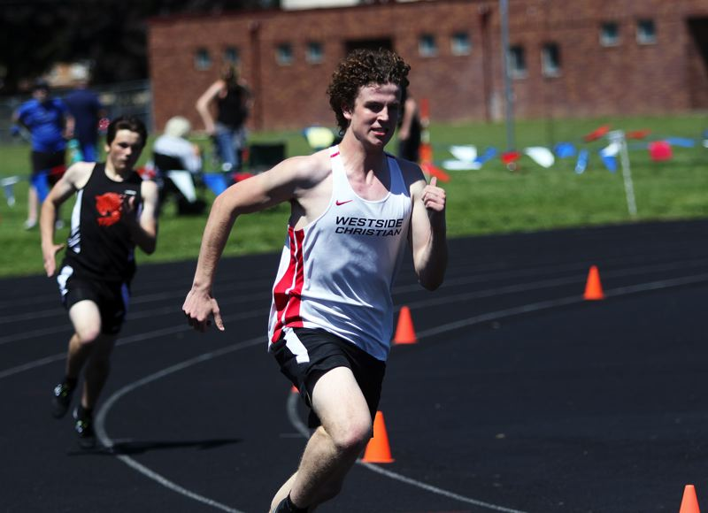 TIMES PHOTO: DAN BROOD - Westside Christian junior Grant Gardner ran to victory in the 400-meter dash at the West Valley League district track and field meet.